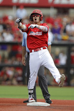 Louisville's Drew Campbell reacts after hitting a double against East Carolina during the third inning in Game 2 of the NCAA college baseball super regional tournament, Saturday, June 8, 2019, in Louisville, Ky. (AP Photo/Darron Cummings)