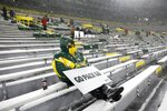 A few fans watch in Lambeau Field during the first half of an NFL football game between the Green Bay Packers and the Tennessee Titans Sunday, Dec. 27, 2020, in Green Bay, Wis. (AP Photo/Mike Roemer)