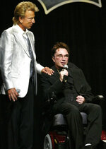 FILE - In this Saturday, Sept. 18, 2004, file photo, magicians Siegfried Fischbacher, left, and Roy Horn appear at the Four Seasons hotel in Las Vegas, where Horn received an award from the Clark County Public Education Foundation. Horn, one half of the longtime Las Vegas illusionist duo Siegfried & Roy, died of complications from the coronavirus, Friday, May 8, 2020. He was 75. (Ralph Fountain/Las Vegas Review-Journal via AP, File)