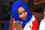 FILE - In this Feb. 5, 2019, file photo, Rep. Ilhan Omar, D-Minn., listens to President Donald Trump's State of the Union speech, at the Capitol in Washington. Omar