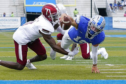 Middle Tennessee quarterback Asher O'Hara (10) reaches for the goal line to score a touchdown on a 2-yard run as Troy safety Craig Slocum (4) closes in during the first half of an NCAA college football game Saturday, Sept. 19, 2020, in Murfreesboro, Tenn. (AP Photo/Mark Humphrey)