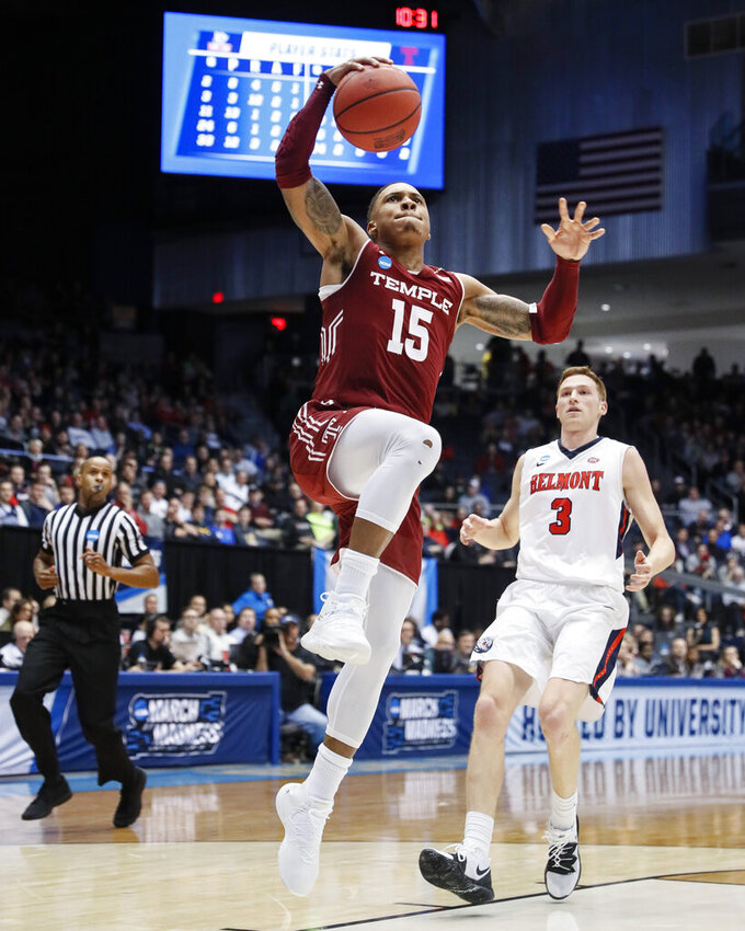 Temple's Nate Pierre-Louis (15) shoots as Belmont's Dylan Windler (3) looks on during the second half of a First Four game of the NCAA college basketball tournament, Tuesday, March 19, 2019, in Dayton, Ohio. (AP Photo/John Minchillo)