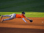 Houston Astros third baseman Alex Bregman cannot get to a ball hit for a single by Los Angeles Angels' Anthony Rendon during the eighth inning of a baseball game Saturday, Aug. 1, 2020, in Anaheim, Calif. (AP Photo/Mark J. Terrill)