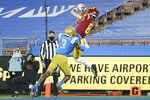 Southern California wide receiver Amon-Ra St. Brown (8) catches a pass in the end zone for a touchdown while defended by UCLA defensive back Rayshad Williams (3) during the fourth quarter of an NCAA college football game Saturday, Dec 12, 2020, in Pasadena, Calif. (AP Photo/Ashley Landis)