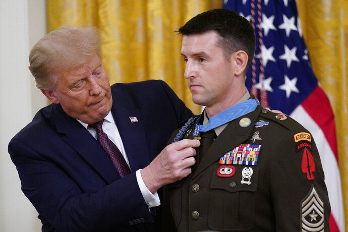 President Donald Trump awards the Medal of Honor to Army Sgt. Maj. Thomas P. Payne in the East Room of the White House on Friday, Sept. 11, 2020, in Washington. (AP Photo/Andrew Harnik)