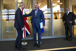 UK Brexit secretary Stephen Barclay, left, is welcomed by European Union chief Brexit negotiator Michel Barnier next to British Ambassador to the EU Tim Barrow, right, before their meeting at the European Commission headquarters in Brussels, Friday, Oct. 11, 2019. (AP Photo/Francisco Seco, Pool)