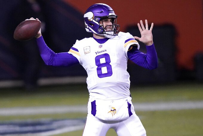 Minnesota Vikings quarterback Kirk Cousins warms up before the start of an NFL football game against the Chicago Bears Monday, Nov. 16, 2020, in Chicago. (AP Photo/Charles Rex Arbogast)