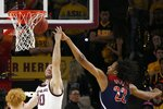 Arizona State forward Mickey Mitchell (00) has his shot blocked by Arizona forward Zeke Nnaji (22) during the first half of an NCAA college basketball game Saturday, Jan. 25, 2020, in Tempe, Ariz. (AP Photo/Ross D. Franklin)
