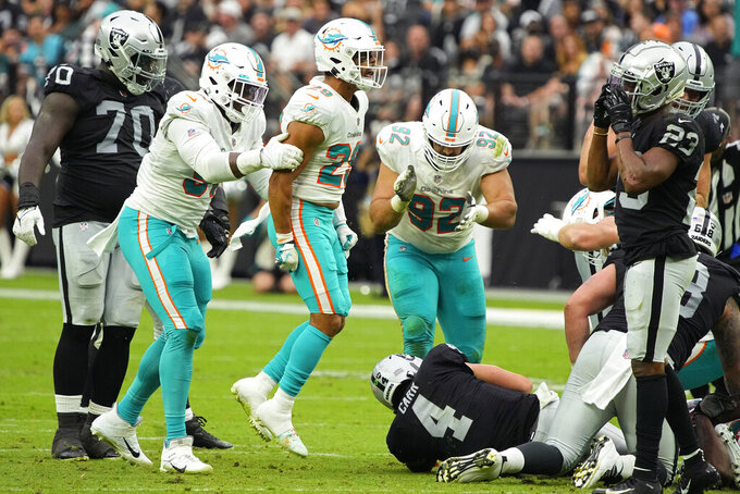 Miami Dolphins defensive back Brandon Jones (29) celebrates after sacking Las Vegas Raiders quarterback Derek Carr (4) during the first half of an NFL football game, Sunday, Sept. 26, 2021, in Las Vegas. (AP Photo/Rick Scuteri)