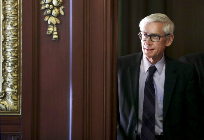 FILE - In this March 21, 2019 file photo, Governor Tony Evers arrives to a ceremony at the State Capitol in Madison, Wis. Gov. Evers made it official Saturday, June 5, 2021, announcing his bid for a second term in the battleground state where he stands as a Democratic block to the Republican-controlled state Legislature.(Steve Apps/Wisconsin State Journal via AP)