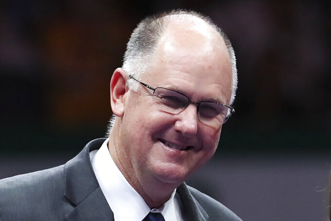 FILE - In this Oct. 29, 2017, file photo, WTA Chief Executive Officer Steve Simon smiles during a retirement ceremony for Martina Hingis in Singapore. The heads of the ATP and WTA professional tennis tours tell the AP that they are coordinating with each other as they weigh how to reschedule the sport's calendar for whenever play can resume after the COVID-19 pandemic.(AP Photo/Yong Teck Lim, File)