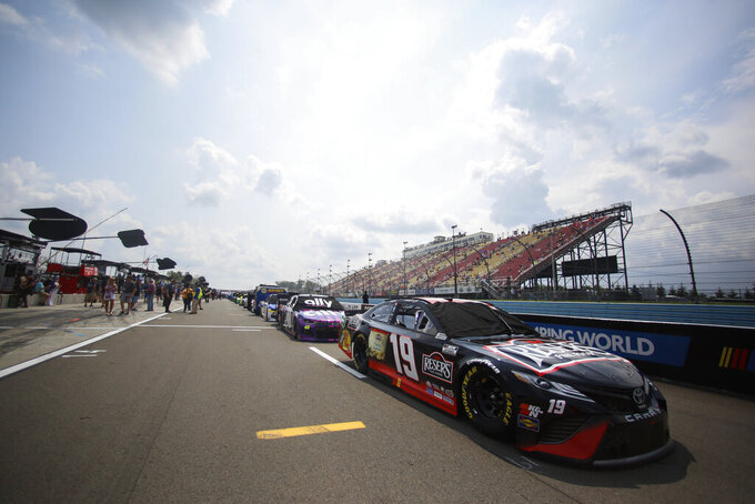 Cars line up before a NASCAR Cup Series auto race in Watkins Glen, N.Y., on Sunday, Aug. 8, 2021. (AP Photo/Joshua Bessex)