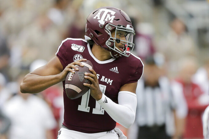 Texas A&M quarterback Kellen Mond (11) looks to pass against Alabama during the first quarter of an NCAA college football game, Saturday, Oct. 12, 2019, in College Station, Texas. (AP Photo/Sam Craft)
