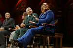 Music artist and actress Queen Latifah applauds alongside billionaire businessman Robert F. Smith during ceremonies at Harvard University where they and others received W.E.B. Dubois Medals for contributions to black history and culture, Tuesday, Oct. 22, 2019, in Cambridge, Mass. (AP Photo/Elise Amendola)