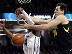 Iowa forward Ryan Kriener, right, battles for a rebound against Northwestern forward Vic Law during the first half of an NCAA college basketball game Wednesday, Jan. 9, 2019, in Evanston, Ill. (AP Photo/Nam Y. Huh)
