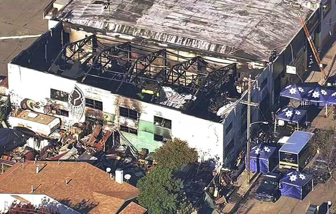 FILE - This Dec. 3, 2016, file image from video provided by KGO-TV shows the Ghost Ship Warehouse after a fire swept through the building in Oakland, Calif. A man charged with manslaughter in the Ghost Ship blaze that killed 36 partygoers at a firetrap warehouse in Northern California may be released from jail because of the coronavirus outbreak, a judge ruled. An Alameda County Superior Court Judge has decided to release Derick Almena from custody at Santa Rita Jail in Dublin and place him in an electronic monitoring program while he awaits retrial, officials said Wednesday, April 8, 2020. (KGO-TV via AP, File)
