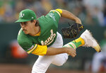 Oakland Athletics pitcher Daniel Mengden works against the Seattle Mariners during the first inning of a baseball game Tuesday, July 16, 2019, in Oakland, Calif. (AP Photo/Ben Margot)