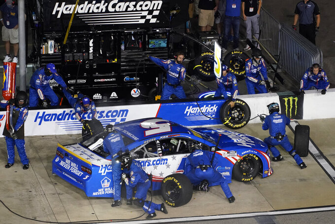 Kyle Larson (5) makes a pit stop during the NASCAR Cup series auto race in Richmond, Va., Saturday, Sept. 11, 2021. (AP Photo/Steve Helber)
