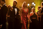 This image released by Lionsgate shows Seth Rogen, left, and Charlize Theron in a scene from