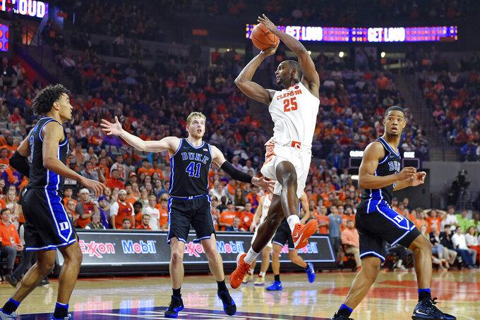 Clemson's Aamir Simms makes a pass (25) under the basket during the second half of an NCAA college basketball game against Duke Tuesday, Jan. 14, 2020, in Clemson, S.C. Clemson won 79-72. (AP Photo/Richard Shiro)