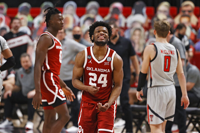 Oklahoma's Elijah Harkless (24) reacts after fouling Texas Tech's Terrence Shannon Jr. (not shown) during the second half of an NCAA college basketball game Monday, Feb. 1, 2021, in Lubbock, Texas. (AP Photo/Brad Tollefson)