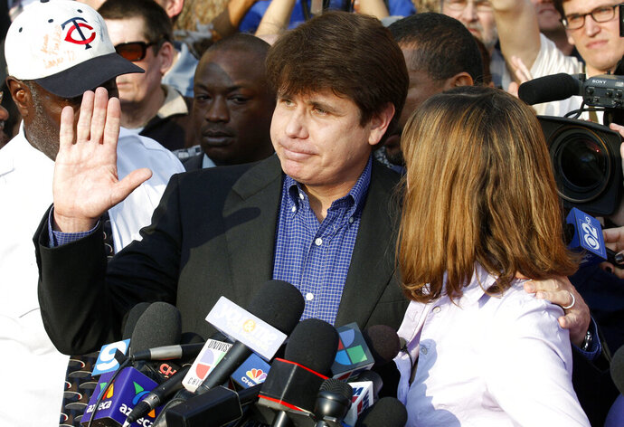 FILE - In this March 14, 2012, file photo, former Illinois Gov. Rod Blagojevich, with his wife Patti at his side, speaks to the media in Chicago before reporting to federal prison in Denver. President Donald Trump says he's