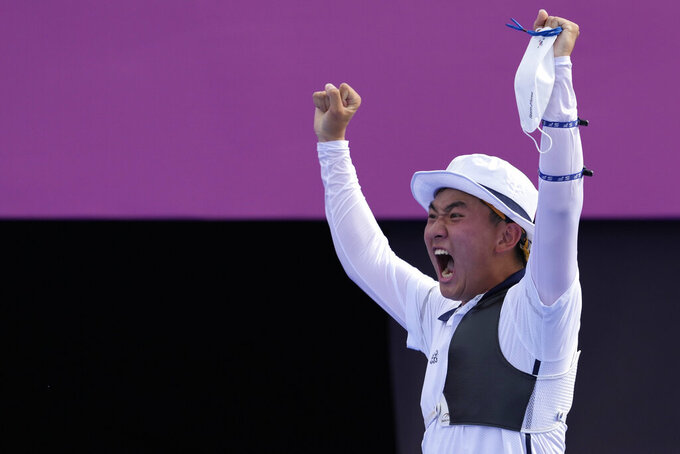 South Korea's Kim Je Deok celebrates at the end of the men's team semifinal match against Japan at the 2020 Summer Olympics, Monday, July 26, 2021, in Tokyo, Japan. (AP Photo/Alessandra Tarantino)