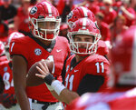 FILE - In this Sept. 1, 2018, file photo, Georgia quarterback Jake Fromm (11) warms up as quarterback Justin Fields looks on before an NCAA college football game against Austin Peay, in Athens, Ga. Fromm is Georgia's starting quarterback. There is no question about that. How much playing time, if any, does that leave for touted freshman Justin Fields? (Curtis Compton/Atlanta Journal-Constitution via AP, File)/Atlanta Journal-Constitution via AP)