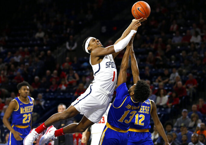 Richmond's Blake Francis (1), stretches toward the basket during the first half of an NCAA college basketball game, Friday, Nov. 22, 2019 in Richmond, Va. (Dean Hoffmeyer/Richmond Times-Dispatch via AP)