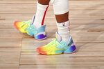 Shoes worn by Toronto Raptors guard Kyle Lowry (7) are seen during the first half of an NBA basketball game against the Orlando Magic Wednesday, Aug. 5, 2020, in Lake Buena Vista, Fla. (Kim Klement/Pool Photo via AP)