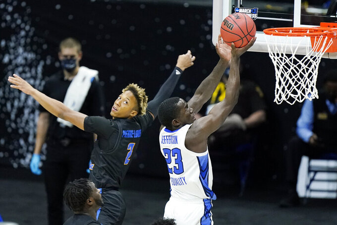 Creighton's Damien Jefferson (23) scores against UC Santa Barbara's Josh Pierre-Louis (2) during the first half of a college basketball game in the first round of the NCAA tournament at Lucas Oil Stadium in Indianapolis Saturday, March 20, 2021. (AP Photo/Mark Humphrey)