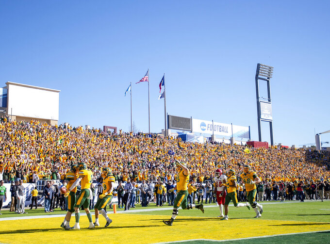 North Dakota State players celebrate in the end zone after quarterback Easton Stick (12) scored the final touchdown of the game against Eastern Washington during the second half of the FCS championship NCAA college football game, Saturday, Jan. 5, 2019, in Frisco, Texas. North Dakota State won 38-24. (AP Photo/Jeffrey McWhorter)