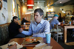 Democratic presidential candidate and former Texas congressman Beto O'Rourke speaks with a reporter while eating lunch at a restaurant Sunday, March 24, 2019, in Las Vegas. (AP Photo/John Locher)