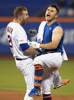 New York Mets' J.D. Davis, right, celebrates with Todd Frazier (21) after Davis drove in the game-winning run with a single during the 10th inning of the team's baseball game against the Cleveland Indians on Wednesday, Aug. 21, 2019, in New York. The Mets won 4-3. (AP Photo/Mary Altaffer)