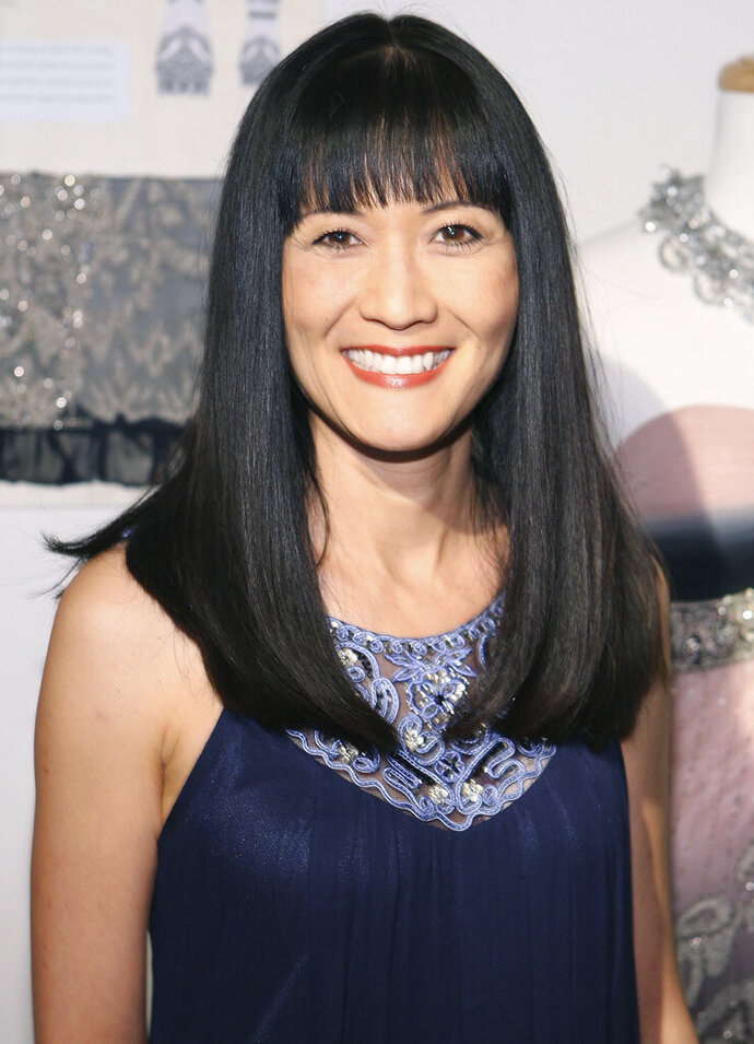 FILE - In this March 6, 2010 file photo, Suzanne Whang attends the Sue Wong Fall 2010 Preview, in Los Angeles. Whang, whose smooth, calm voice provided the narration for HGTV's