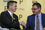 Ben Cherington, left, shakes hands with recently hired team president Travis Williams as he is introduced as the new general manager of the Pittsburgh Pirates baseball team at a news conference, Monday, Nov. 18, 2019, in Pittsburgh. (AP Photo/Keith Srakocic)