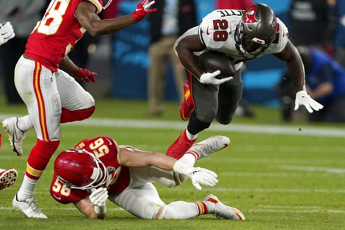 Tampa Bay Buccaneers running back Leonard Fournette (28) is upended by Kansas City Chiefs outside linebacker Ben Niemann (56) during the second half of the NFL Super Bowl 55 football game, Sunday, Feb. 7, 2021, in Tampa, Fla. (AP Photo/Lynne Sladky)