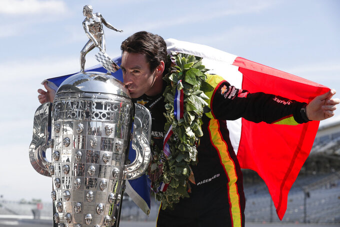 Simon Pagenaud, of France, winner of the 2019 Indianapolis 500 auto race, poses during the traditional winners photo session at the Indianapolis Motor Speedway in Indianapolis, Monday, May 27, 2019. (AP Photo/Michael Conroy)