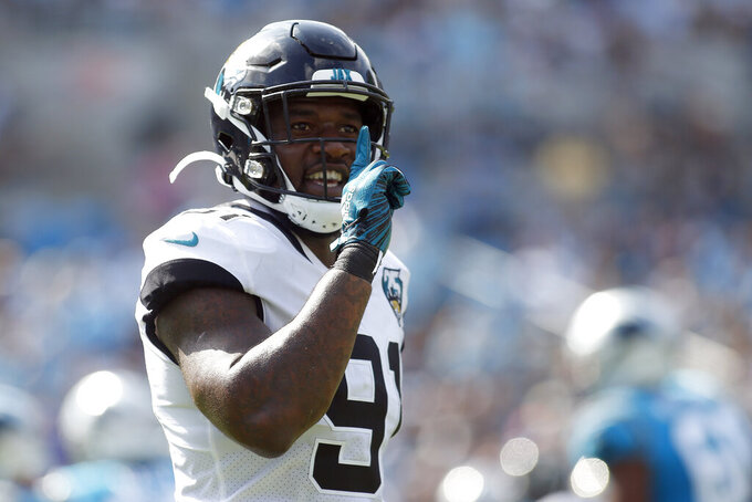 FILE - Then-Jacksonville Jaguars defensive end Yannick Ngakoue (91) reacts following a play against the Carolina Panthers during the first half of an NFL football game in Charlotte, N.C., Sunday, Oct. 6, 2019. NFL teams can always use more pass rushers, as evidenced by the NFC North where all four teams have spent big to acquire them over the last three years. Minnesota, trying to overtake defending division champ Green Bay, was the latest example with the acquisition of defensive end Yannick Ngakoue.(AP Photo/Brian Blanco, File)