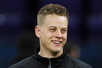 FILE - In this Thursday, Feb. 27, 2020, file photo, LSU quarterback Joe Burrow watches a drill at the NFL football scouting combine in Indianapolis. Burrow is a likely first round pick in the NFL Draft Thursday, April 23, 2020. (AP Photo/Charlie Neibergall, File)