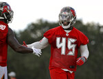 Tampa Bay Buccaneers linebacker Devin White (45) celebrates with free safety Jordan Whitehead after breaking up a pass during an NFL football training camp practice Saturday, July 27, 2019, in Tampa, Fla. (AP Photo/Chris O'Meara)