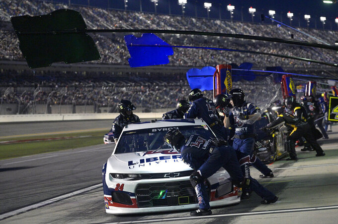 William Byron (24) makes a pit stop during a NASCAR Cup Series auto race at Daytona International Speedway, Saturday, Aug. 28, 2021, in Daytona Beach, Fla. (AP Photo/Phelan M. Ebenhack)