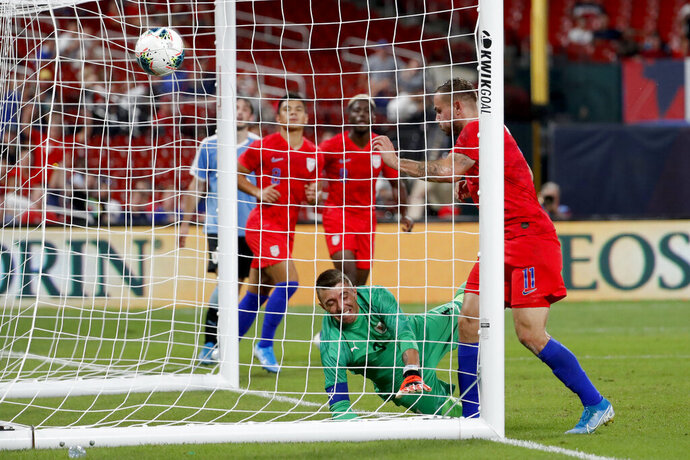United States' Jordan Morris (11) scores past Uruguay goalkeeper Fernando Muslera during the second half of a friendly soccer match Tuesday, Sept. 10, 2019, in St. Louis. The game ended in a 1-1 tie. (AP Photo/Jeff Roberson)