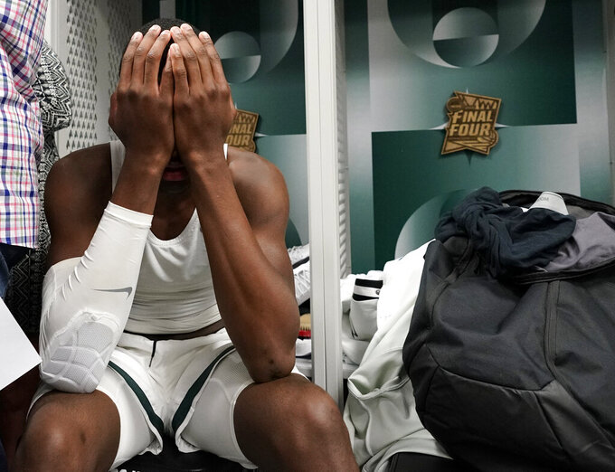 Michigan State's Gabe Brown reacts in the locker room after the team's 61-51 loss to Texas Tech in the semifinals of the Final Four NCAA college basketball tournament, Saturday, April 6, 2019, in Minneapolis. (AP Photo/David J. Phillip)