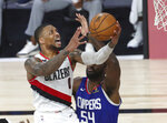 Portland Trail Blazers guard Damian Lillard (0) shoots past Los Angeles Clippers' Patrick Patterson (54) during the second half in an NBA basketball game Saturday, Aug. 8, 2020, in Lake Buena Vista, Fla. (Kim Klement/Pool Photo via AP)