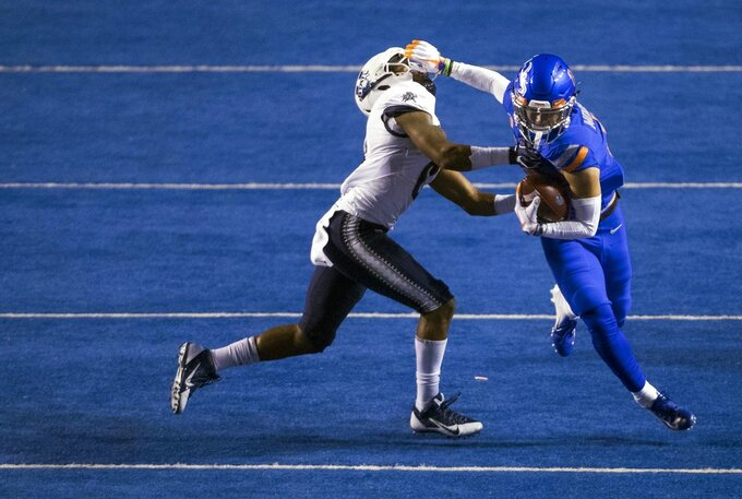 Boise State wide receiver Sean Modster (8) wrestles with Utah State cornerback Cameron Haney (6) after a catch during an NCAA college football game Saturday, Nov. 24, 2018, in Boise, Idaho. (Darin Oswald/Idaho Statesman via AP)