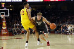 Washington State's Ryan Rapp (22) is defended by Southern California's Isaiah Mobley (15) during the second half of an NCAA college basketball game Saturday, Feb. 15, 2020, in Los Angeles. (AP Photo/Marcio Jose Sanchez)