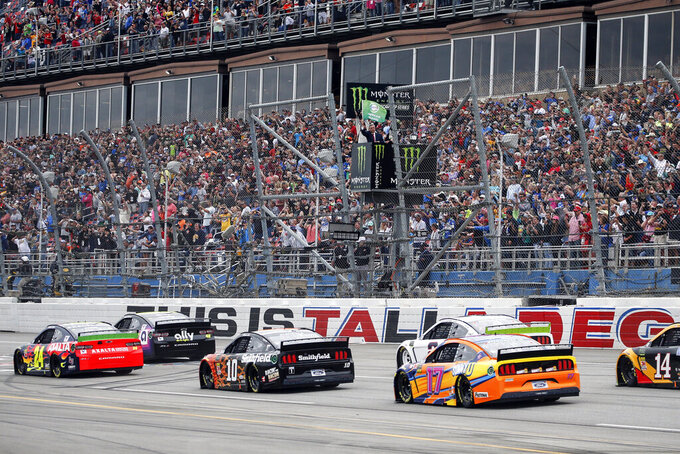The Latest: Rain forces playoff postponement at Talladega