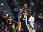 Murray State's Ja Morant (12) reacts during the first half of a first round men's college basketball game against Marquette in the NCAA tournament, Thursday, March 21, 2019, in Hartford, Conn. (AP Photo/Jessica Hill)