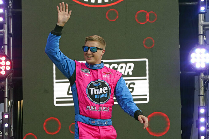 Garrett Smithley waves to fans during driver introductions before the NASCAR Cup Series auto race at Daytona International Speedway, Saturday, Aug. 28, 2021, in Daytona Beach, Fla. (AP Photo/John Raoux)